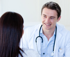 Portrait of a male doctor talking with his patient