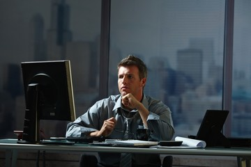 Businessman working late in office