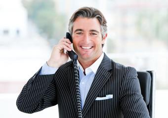 Self-assured mature businessman talking on phone