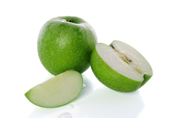 The green apple and segment is isolated on the white