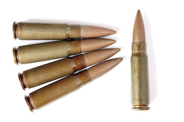Five old and messy bullets isolated on white background