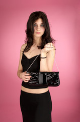 Beautiful young woman with handbag