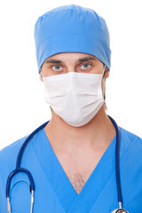 portrait of doctor in mask and blue uniform
