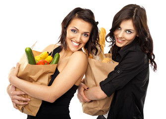 Two women holding groceries