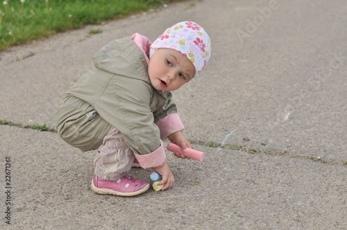 baby drawing on asphalt