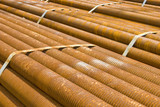 Industrial cargo for shipment: rusty pipes