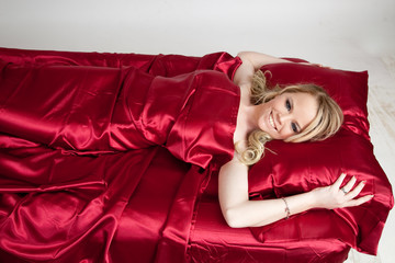 beautiful blond in red satin sheets