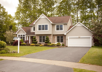 Beautiful house with SOLD sign on front lawn