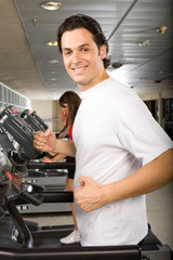 Attractive man n a treadmill