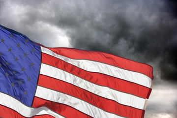 Storm clouds behind an American Flag