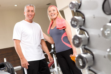 Happy couple in a fitness studio