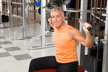 Happy mature man in the gym