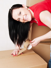 woman holding and packing cardboard boxes