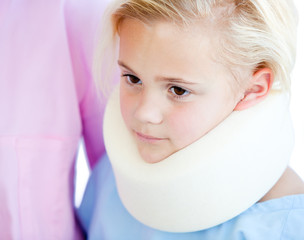 Close-up of a little girl with a neck brace