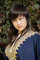 Asian girl in dark blue robe.