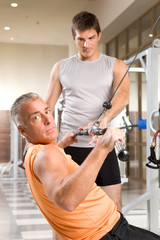 Mature man learning how to do an exercise