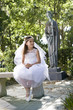 Young girl in outdoors wearing first communion dress