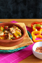 Chicken with red and yellow peppers