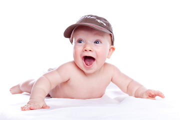 happy baby in a baseball cap on ehite background