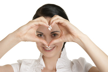 Young woman shows fingers heart symbol