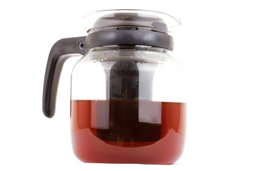 glass teapot isolated on a white background. Black tea
