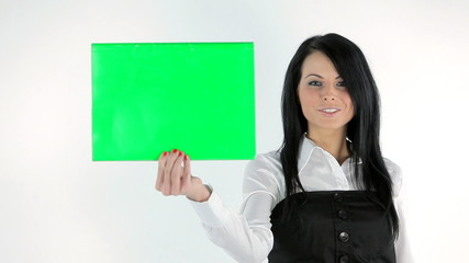 beautiful woman holds a green screen