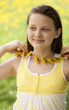 girl with dandelion necklace