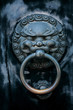 antique oriental door knocker .