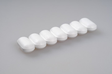 White pills packed in a row