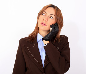 Young attractive businesswoman talking on the cell phone