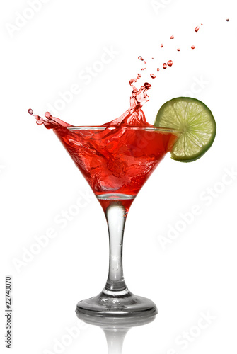 Fotobehang Bar Red cocktail with splash and lime isolated on white