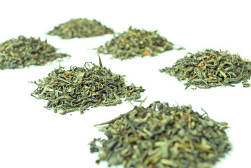 Piles of green tea, isolated on white