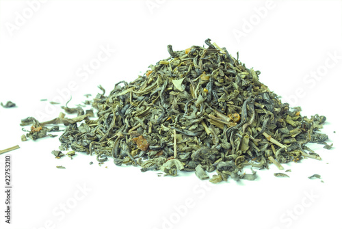 Pile of green tea isolated on white