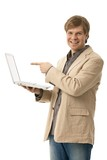 Young man holding laptop with blank screen