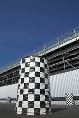 checkered trash cans outside a sports arena grandstand