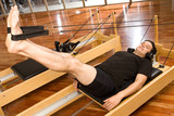 Pilates man on a reformer