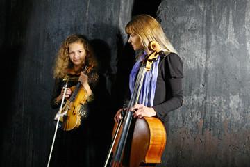 Ñello and violin musicians