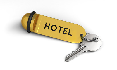 Hotel key with golden keyring on the floor
