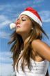 Santa girl with a cloudy sky