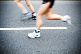 People running in marathon race on city streets