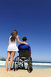 woman and husband in wheelchair on the beach