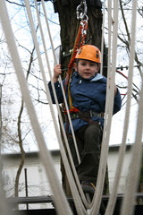 Child climbing in adventure playground.