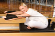 Woman stretching during pilates
