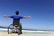 insurance: man in wheelchair enjoying the  beach
