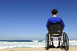man in a wheelchair watching the sea