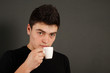 Young guy drinking coffee