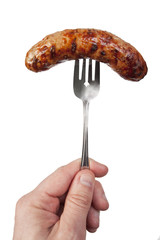 cooked sausage on a fork