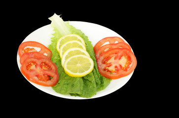 Fresh green Salad with tomato, lemon and lettuce
