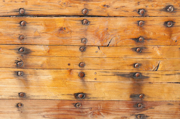 Wooden planks tightened with Nails and roves in a boat