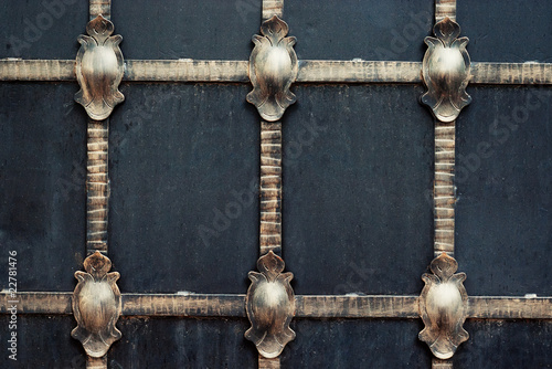 black wrought iron gates texture with golden colored pattern